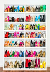 A Shoe Closet (wardrobe) with lots of colorfull High Heels shoes.